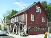 """<p>Yet another town that bears the distinction of being """"<a href=""""https://www.bostonglobe.com/magazine/2013/05/25/spots-shop-for-antiques/5QOLbMdzIMgXrHH96e3DjI/story.html"""" rel=""""nofollow noopener"""" target=""""_blank"""" data-ylk=""""slk:America's Antique Capital"""" class=""""link rapid-noclick-resp"""">America's Antique Capital</a>,"""" Essex offers a diverse array of dealers — from high-end (<a href=""""http://www.davidneliganantiques.com/"""" rel=""""nofollow noopener"""" target=""""_blank"""" data-ylk=""""slk:David Neligan Antiques"""" class=""""link rapid-noclick-resp"""">David Neligan Antiques</a>) to the more down-to-earth (shown here, <a href=""""http://www.whiteelephantshop.com/"""" rel=""""nofollow noopener"""" target=""""_blank"""" data-ylk=""""slk:The White Elephant Shop"""" class=""""link rapid-noclick-resp"""">The White Elephant Shop</a>, which boasts an outlet store on the second story). </p><p><a href=""""https://flic.kr/p/dMAT59"""" rel=""""nofollow noopener"""" target=""""_blank"""" data-ylk=""""slk:[link href=&quot;https://flic.kr/p/dMAT59&quot; target=&quot;_blank&quot; link_updater_label=&quot;external&quot;]Photo via Flickr"""" class=""""link rapid-noclick-resp""""><em>[link href=""""https://flic.kr/p/dMAT59"""" target=""""_blank"""" link_updater_label=""""external""""]Photo via Flickr</em></a></p>"""
