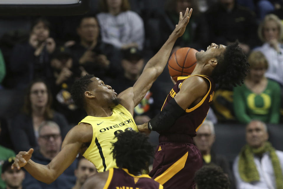 Oregon's Francis Okoro, left, fouls Arizona State's Remy Martin during the first half of an NCAA college basketball game in Eugene, Ore., Saturday, Jan. 11, 2020. (AP Photo/Chris Pietsch)