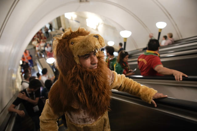 A Morocco fan wearing a lion costume arrives at Sportivnaya metro station to attend the group B match between Portugal and Morocco at the 2018 soccer World Cup in the Luzhniki Stadium in Moscow, Russia, Wednesday, June 20, 2018. (AP Photo/Victor R. Caivano)