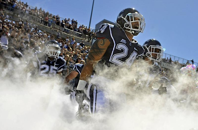 FILE - In this Sept. 11, 2010, file photo, Connecticut's D.J. Shoemate (24) shouts as he runs onto the field for NCAA college football game against Texas Southern in East Hartford, Conn. Big East football schools will get almost all of a $110 million pot in a deal that will allow seven departing basketball schools to keep the name Big East and start playing in their own conference next season, a person familiar with the negotiations says. They will receive approximately $100 million under the agreement, most of which will go to holdover members Connecticut, South Florida and Cincinnati. (AP Photo/Jessica Hill, File)