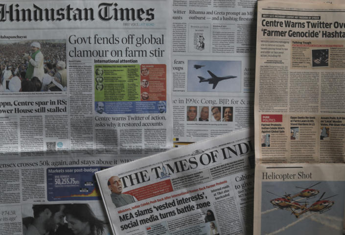 Indian newspapers carry news of people from India and outside tweeting about the farmer protests in New Delhi, India, Thursday, Feb. 4, 2021. It took just one tweet from pop star Rihanna to anger the Indian government and supporters of Prime Minister Narendra Modi's party, after she tweeted about the farmer protests that have gripped India. Now, senior Indian ministers, Bollywood celebrities, sports stars, journalists close to Modi's party and a rare statement by India's foreign ministry urging Indians to unite and denounce voices from outside India who try to break the country. (AP Photo/Manish Swarup)