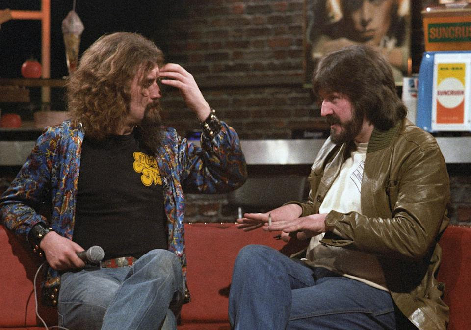 <p>Billy Connolly, left, interviewing John Bonham in 1979, the year before Bonham's death</p>Rex