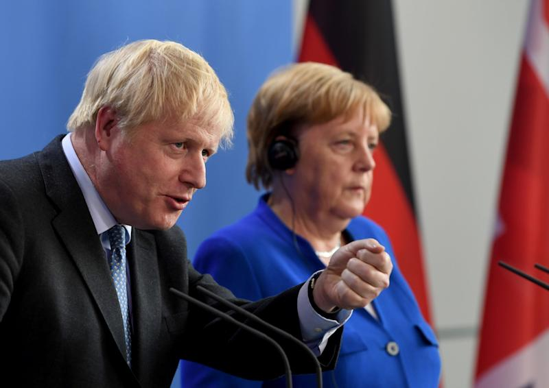 Boris Johnson and Angela Merkel give a joint press statement at the Chancellery in Berlin: EPA