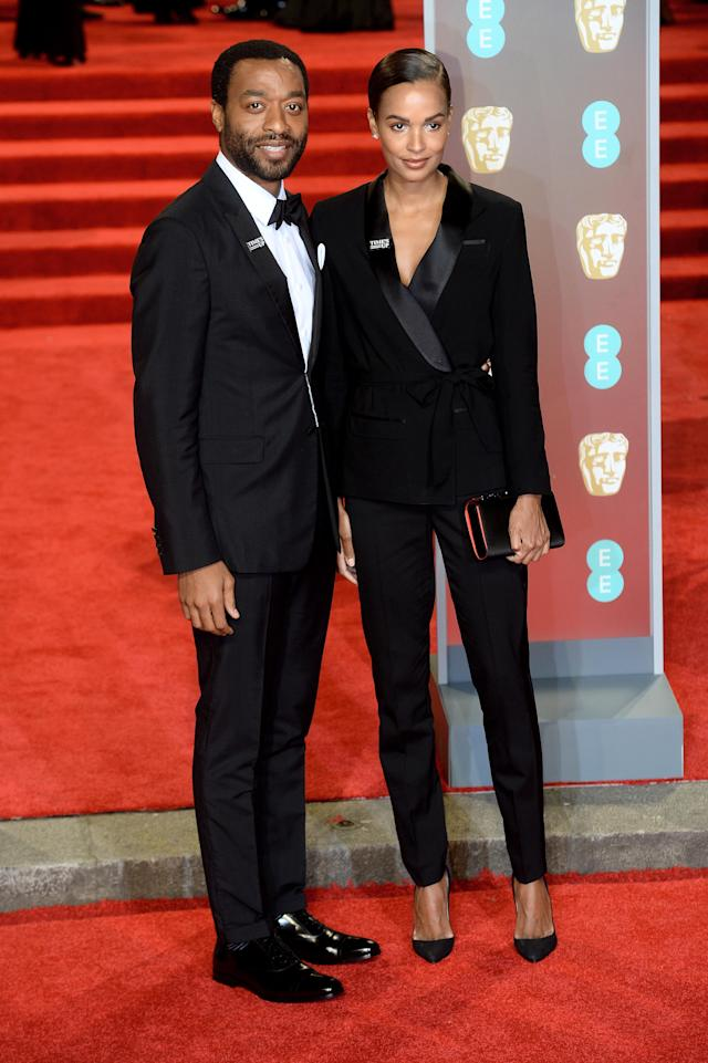 <p>The actor and his model flame coordinated in trouser suits. <em>[Photo: Getty]</em> </p>