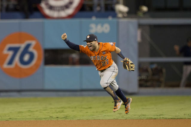 <p>Jose Altuve #27 of the Houston Astros celebrates on the field after the Astros defeated the Los Angeles Dodgers in Game 7 of the 2017 World Series at Dodger Stadium on Wednesday, November 1, 2017 in Los Angeles, California. (Photo by Rob Tringali/MLB Photos via Getty Images) </p>