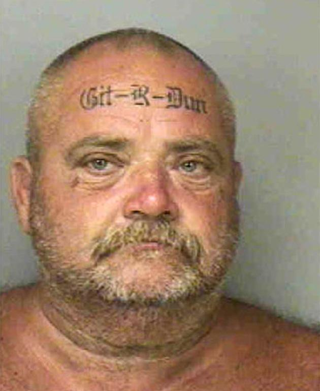 Floyd Bebee, 48, from Florida has 'Git-R-Dun' tattooed on his forehead. The father of Justin 'Psycho' Beebee' also has 'Got-R-Did' tattooed on the back of his head. His crime is unknown (Rex Features)