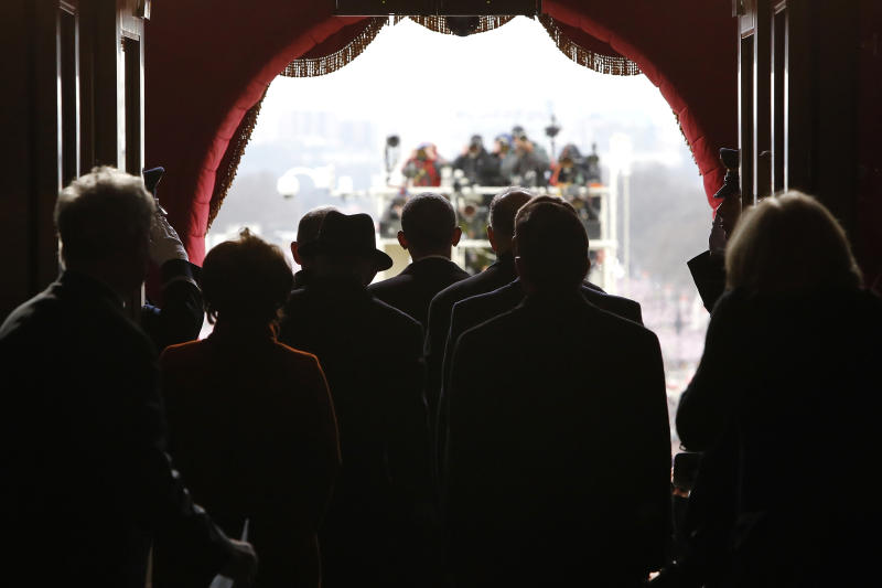 President Barack Obama pauses with his escorts before walking through the Lower West Terrace Door on Capitol Hill in Washington, Monday, Jan. 21, 201, for his ceremonial swearing-in ceremony during the 57th Presidential Inauguration.  (AP Photo/Jonathan Ernst, Pool)