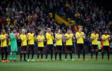 Soccer Football - Premier League - Watford vs Burnley - Vicarage Road, Watford, Britain - April 7, 2018 Watford players line up during a minute's applause in memory of Ray Wilkins REUTERS/David Klein/Files