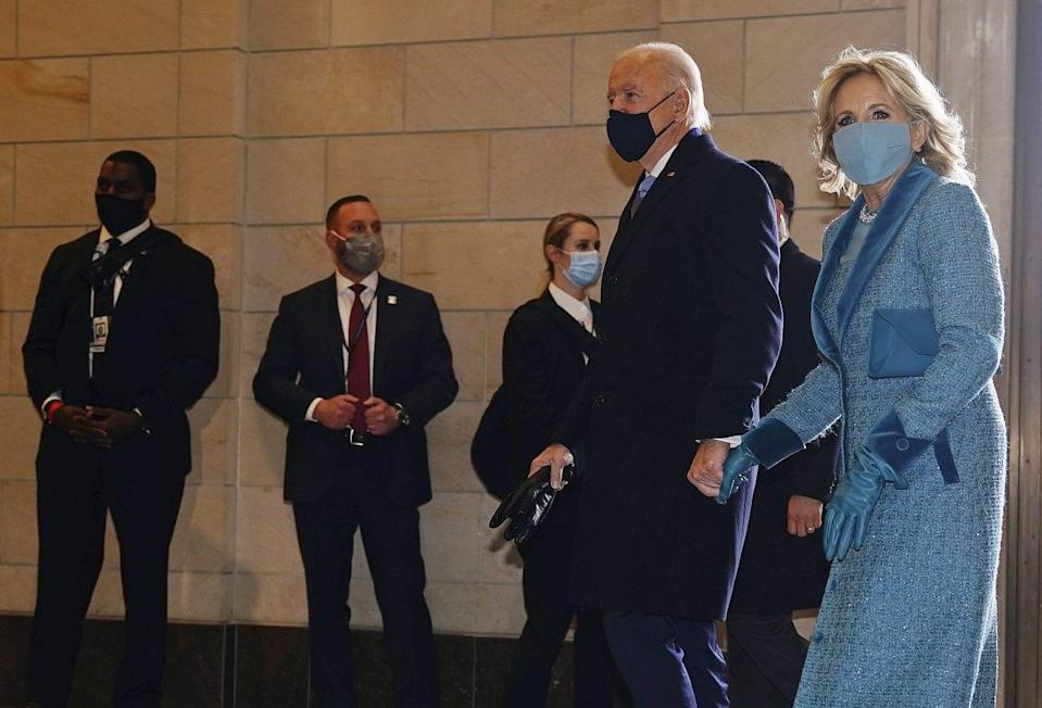 President-elect Joe Biden and his wife Jill Biden arrive at the East Front of the US Capitol ahead of Biden's inauguration at the US Capitol in Washington.