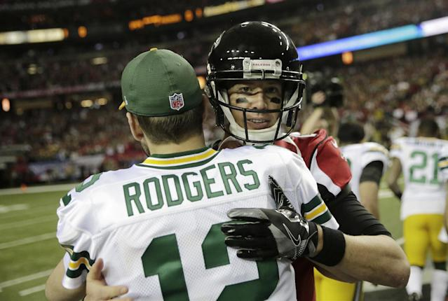 Quarterbacks Aaron Rodgers and Matt Ryan are looking at a big payday in the near future. (AP)