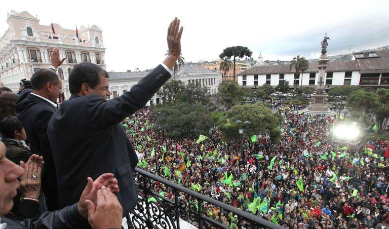 Ecuadorean President Rafael Correa waves to supporters as he celebrates his re-election, in Quito on February 17, 2013