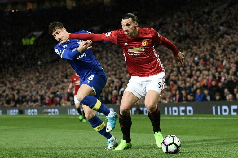 Manchester United's Zlatan Ibrahimovic (R) vies with Everton's Ross Barkley during the English Premier League football match that ended in a 1-1 draw on April 4, 2017