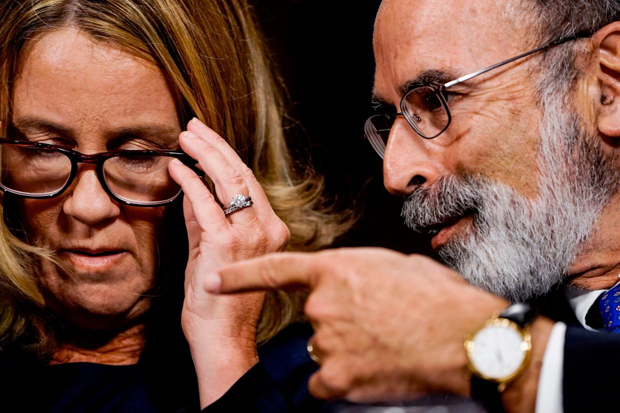 Christine Blasey Ford speaks with her lawyer Michael Bromwich.
