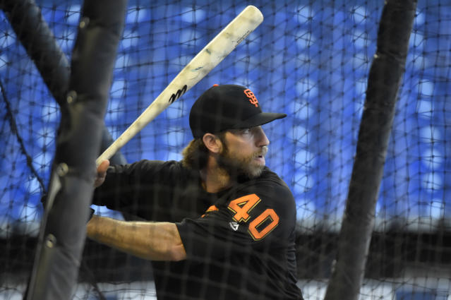 """If the universal DH is adopted, we'd lose out on <a class=""""link rapid-noclick-resp"""" href=""""/mlb/players/8590/"""" data-ylk=""""slk:Madison Bumgarner"""">Madison Bumgarner</a> hitting. (Photo by Eric Espada/Getty Images)"""