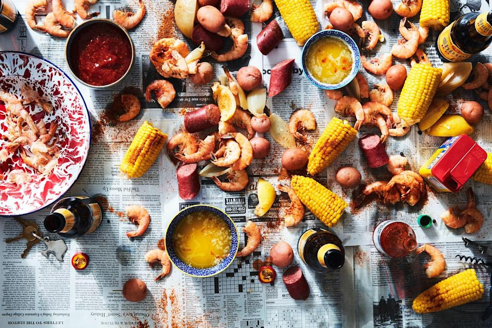 "You'll need your favorite seafood seasoning and your biggest pot for this boil (also called Frogmore Stew, One-Pot, or Farmer's Seafood Boil) brimming with plump shrimp, sweet corn, smoky sausage, and tender potatoes. Call all your friends and spread out some newspaper for a fun, roll-up-your-sleeves meal that will feed a crowd. <a href=""https://www.epicurious.com/recipes/food/views/low-country-boil-with-shrimp-corn-and-sausage?mbid=synd_yahoo_rss"" rel=""nofollow noopener"" target=""_blank"" data-ylk=""slk:See recipe."" class=""link rapid-noclick-resp"">See recipe.</a>"