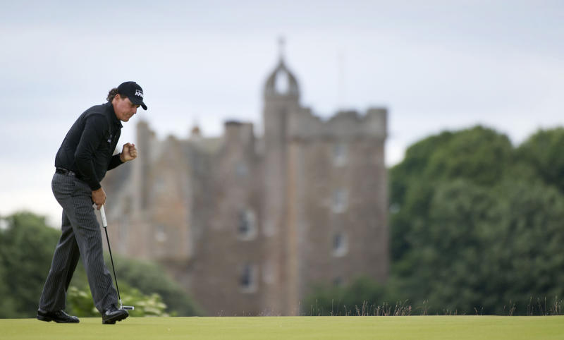 US golfer Phil Mickelson reacts to holing a birdie putt on the 4th hole during day four of the Scottish Open golf championship at Castle Stuart Golf Course, Inverness Scotland Sunday July 14, 2013. (AP Photo/Kenny Smith/PA) UNITED KINGDOM OUT