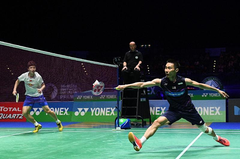 Malaysia's Lee Chong Wei (R) returns to China's Lin Dan during their All England Open Badminton Championships men's singles final match in Birmingham, central England, on March 12, 2017 (AFP Photo/Justin TALLIS)