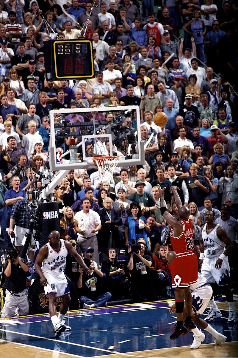 SALT LAKE CITY, UT - JUNE 14: Michael Jordan #23 of the Chicago Bulls shoots the game winning jumpshot against the Utah Jazz during game six of the 1998 NBA Finals played on June 14, 1998 at the Delta Center in Salt Lake City, Utah. NOTE TO USER: User expressly acknowledges and agrees that, by downloading and/or using this Photograph, User is consenting to the terms and conditions of the Getty Images License Agreement. Mandatory copyright notice and Credit: Copyright 1998 NBAE (Photo by Scott Winterton/NBAE via Getty Images)
