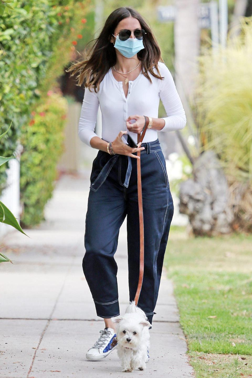 <p>Ana de Armas wears a three-quarter sleeved top with wide leg trousers on her walk with her pooch in L.A. on Wednesday.</p>