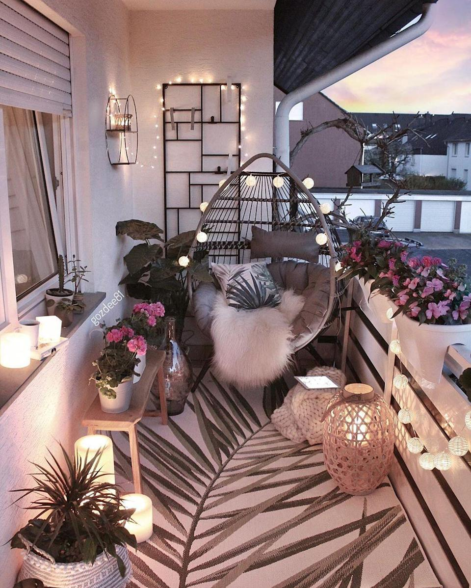 """<p>Battery-operated candles, fairy string lights, and round paper lights make for a dreamy summer balcony situation. Just imagine cozying up with a book or your best friends in this picture-perfect setting.</p><p><strong>See more at <a href=""""https://www.instagram.com/p/Bxsas2NC2BK/"""" rel=""""nofollow noopener"""" target=""""_blank"""" data-ylk=""""slk:gozdee81"""" class=""""link rapid-noclick-resp"""">gozdee81</a>.</strong></p><p><a class=""""link rapid-noclick-resp"""" href=""""https://www.amazon.com/Starry-String-Lights-Flexible-Copper/dp/B01D44HSRG/?tag=syn-yahoo-20&ascsubtag=%5Bartid%7C10050.g.31137877%5Bsrc%7Cyahoo-us"""" rel=""""nofollow noopener"""" target=""""_blank"""" data-ylk=""""slk:SHOP FAIRY LIGHTS""""><strong>SHOP FAIRY LIGHTS</strong></a></p>"""