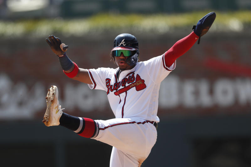 Atlanta Braves center fielder Ronald Acuna Jr. (13) gestures after reaching second base during the fifth inning of a baseball game against the Philadelphia Phillies Thursday, Sept. 19, 2019, in Atlanta. (AP Photo/John Bazemore)
