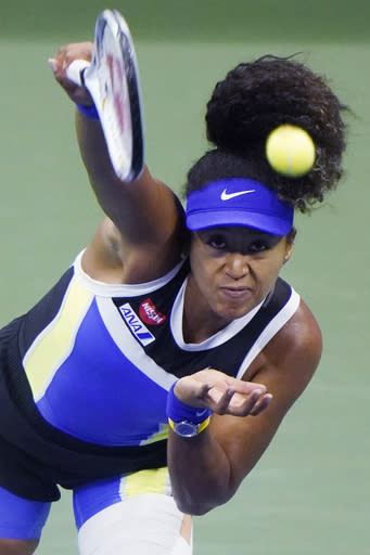 Naomi Osaka, of Japan, serves to Shelby Rogers, of the United States, during the quarterfinal round of the US Open tennis championships, Tuesday, Sept. 8, 2020, in New York. (AP Photo/Frank Franklin II)