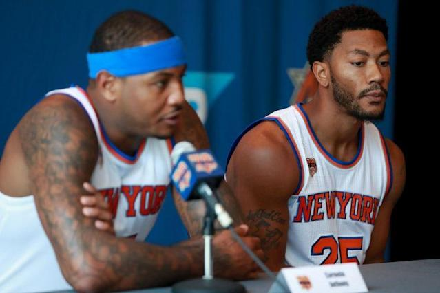 """<a class=""""link rapid-noclick-resp"""" href=""""/nba/players/3706/"""" data-ylk=""""slk:Carmelo Anthony"""">Carmelo Anthony</a> and Derrick Rose at Knicks media day Monday. (Getty Images)"""