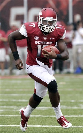 Arkansas quarterback Brandon Mitchell carries against Alabama during the first quarter of an NCAA college football game in Fayetteville, Ark., Saturday, Sept. 15, 2012. (AP Photo/Danny Johnston)
