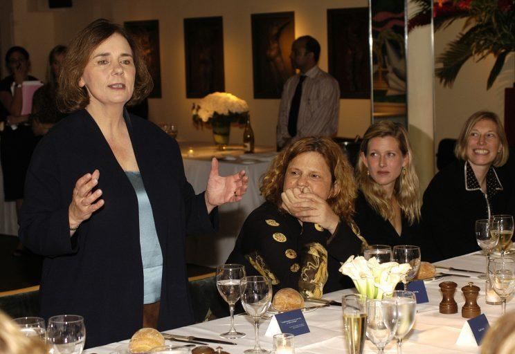Author Gail Collins speaks as Wendy Wasserstein and Karenna Gore Schiff look on at a dinner marking the publication of Collins' book 'America's Women: 400 Years of Dolls, Druges, Helpmates, and Heroines' at Michaels Restaurant September 25, 2003 in New York City.
