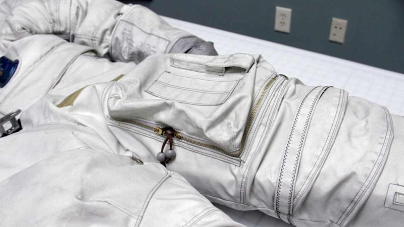 Space suits required material that was durable, strong, lightweight, flexible, and noncombustible, all of which NASA found in fiberglass fabric coated with polytetrafluoroethylene PTFE, commonly known as Teflon. Image courtesy: CollectSpace