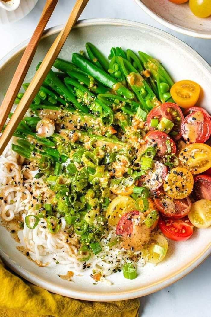 """<p>Shirataki or konjac noodles are a great low-carb alternative to your usual wheat noods—and they also require very little prep work. I can also guarantee you'll want to drizzle this nutty sauce on everything.<br></p><p><a class=""""link rapid-noclick-resp"""" href=""""https://iheartumami.com/shirataki-noodles-peanut-sauce/"""" rel=""""nofollow noopener"""" target=""""_blank"""" data-ylk=""""slk:GET THE RECIPE"""">GET THE RECIPE</a></p><p><em>Per serving: 218 calories, 20 g fat (10 g saturated), 12 g carbs, 2 g sugar, 109 mg sodium, 8 g fiber, 4 g protein</em></p>"""