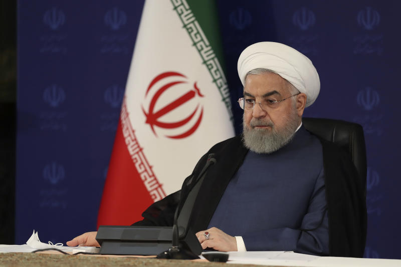 """In this photo released by the official website of the office of the Iranian Presidency, President Hassan Rouhani attends a meeting of the national headquarters of the fight against the COVID-19, in Tehran, Iran, Saturday, July 18, 2020. He estimated as many as 25 million Iranians could have been infected with the coronavirus since the outbreak's beginning, citing an Iranian Health Ministry study that has so far not been made public, the state-run IRNA news agency reported. Writing in Farsi at top right reads, """"The Presidency."""" (Iranian Presidency Office via AP)"""
