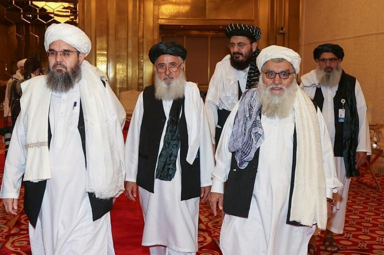 A delegation of Afghanistan's Taliban movement attends a session of peace talks with the Afghan government in the Qatari capital Doha