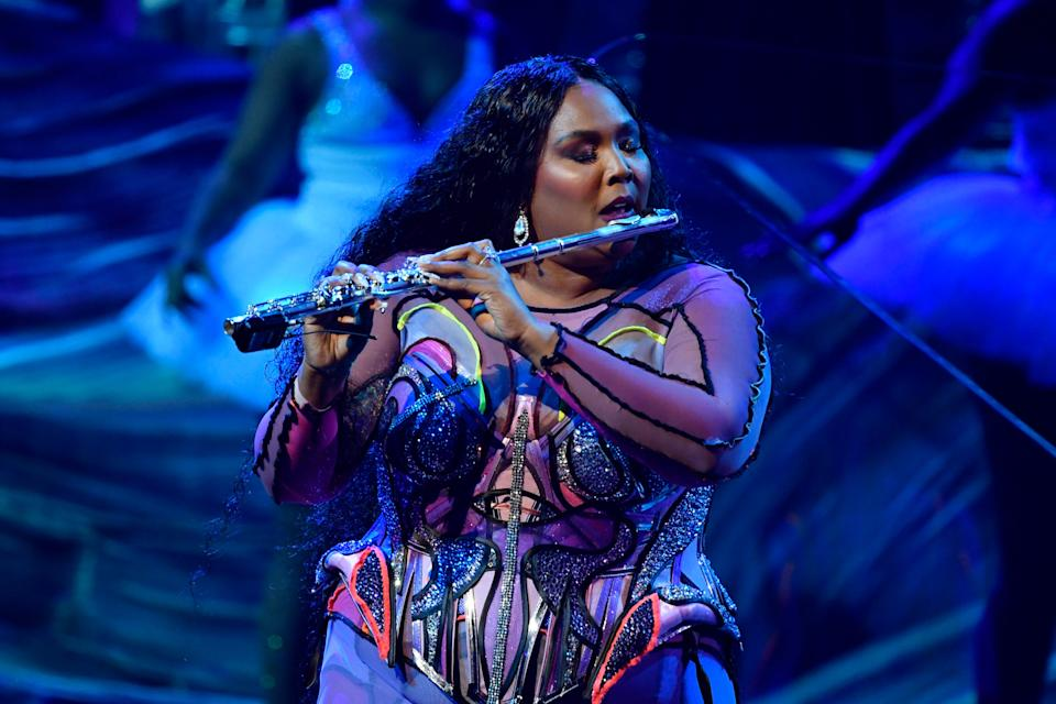 """Lizzo breaks out her flute for """"Truth Hurts"""" in the opening of the 62nd annual Grammy Awards."""