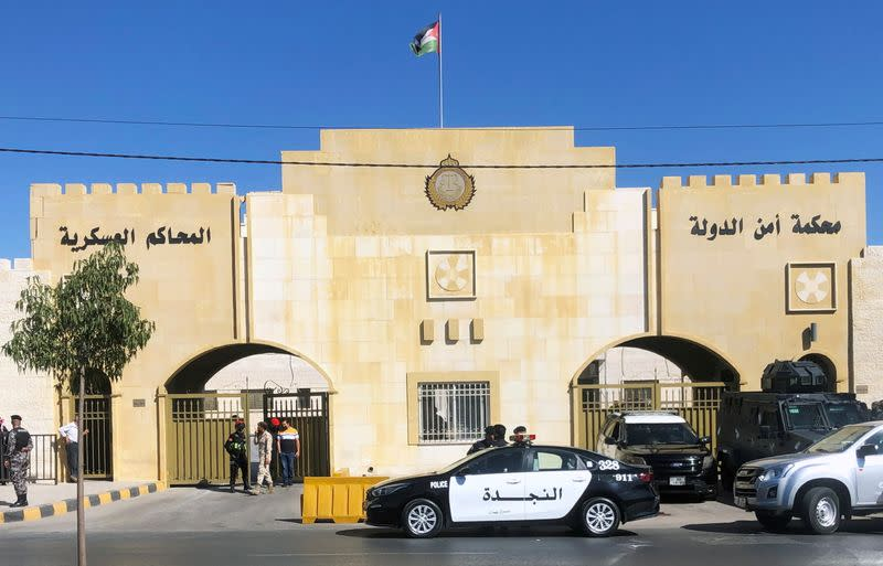 A police vehicle is parked outside a military court in Amman