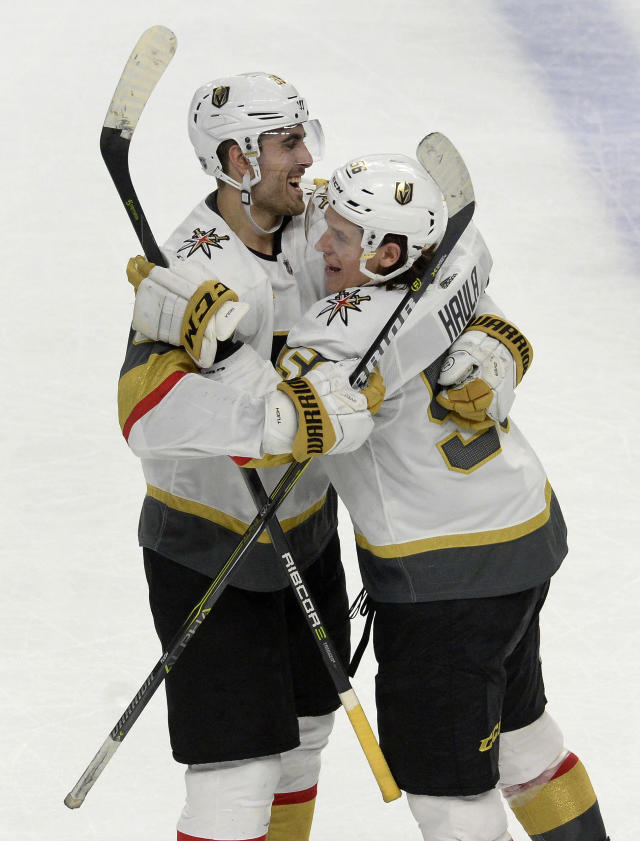 FILE - In this March 10, 2018, file photo, Vegas Golden Knights right wing Alex Tuch (89), left, congratulates left wing Erik Haula after his game-winning goal in the shootout of an NHL hockey game against the Buffalo Sabres, in Buffalo, N.Y. NHL teams face another expansion draft in 2021 when Seattle enters the league. Whoever becomes Seattles GM likely wont receive the windfall of prospects and picks George McPhee got in 2017 to help the Golden Knights reach the Stanley Cup Final because some important lessons have been learned since last time. (AP Photo/Adrian Kraus, File)