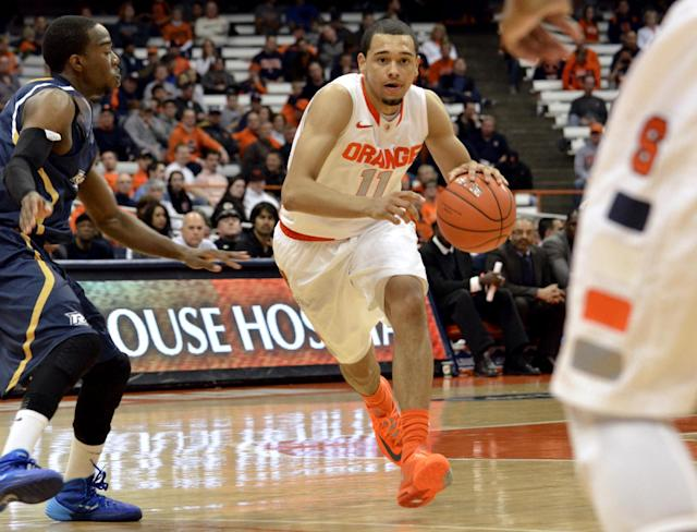 Syracuse's Tyler Ennis looks for an open man against Ryerson during the second half of a men's NCAA exhibition basketball game in Syracuse, N.Y., Tuesday, Nov. 5, 2013. Syracuse won 81-46. (AP Photo/Kevin Rivoli)