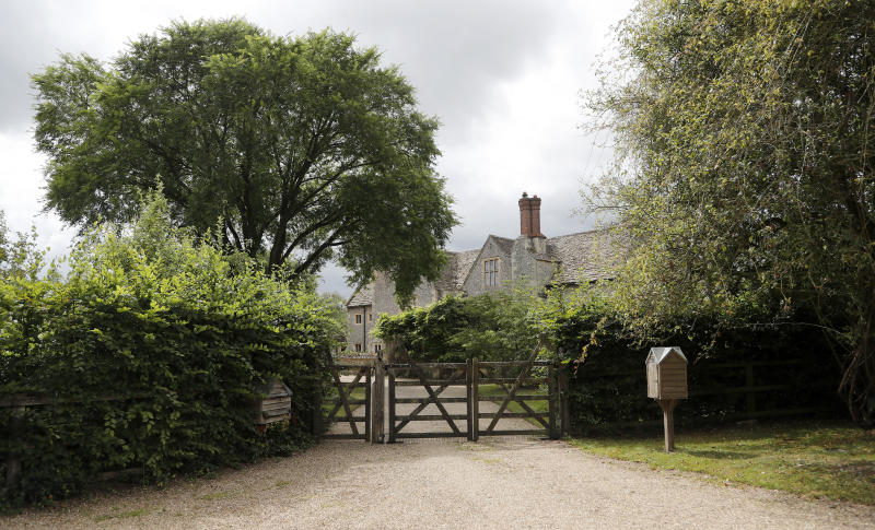 A gate closes off a side entrance of the Rooksnest estate near Lambourn, England, Tuesday, Aug. 6, 2019. The property belongs to the Sackler family, owners of Purdue Pharma based in Stamford, Conn. A complex web of companies and trusts are controlled by the family, and an examination reveals links between far-flung holdings, far removed from the opioid manufacturer's headquarters in the U.S. (AP Photo/Frank Augstein)