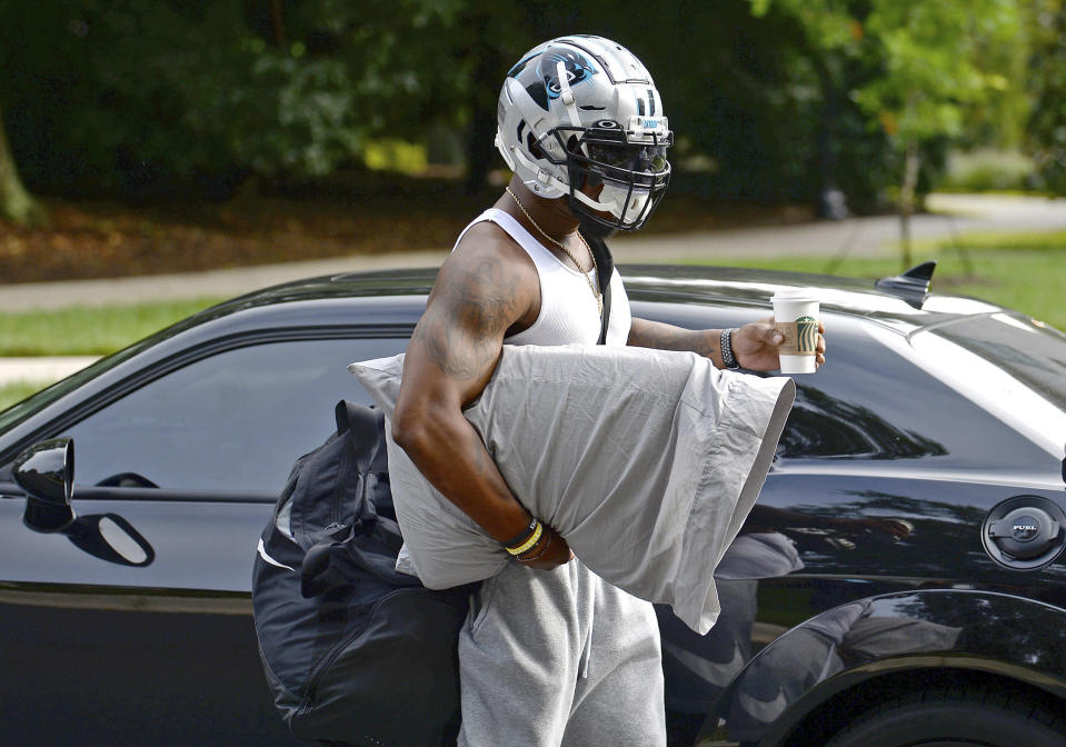 Carolina Panthers linebacker Denzel Perryman has his hand full as he arrives at NFL football training camp, Tuesday, July 27, 2021, at Wofford College in Spartanburg, S.C. (Jeff Siner/The Charlotte Observer via AP)