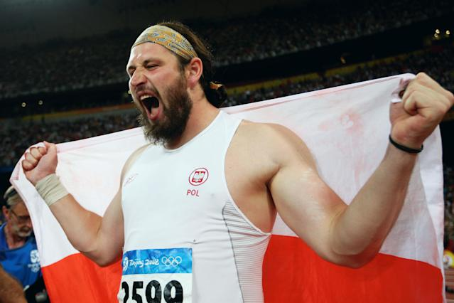 BEIJING - AUGUST 15: Tomasz Majewski of Poland celebrates winning the Men's Shot Put Final and the gold medal at the National Stadium on Day 7 of the Beijing 2008 Olympic Games on August 15, 2008 in Beijing, China. Tomasz Majewski of Poland won with a throw of 21.51m. (Photo by Michael Steele/Getty Images)