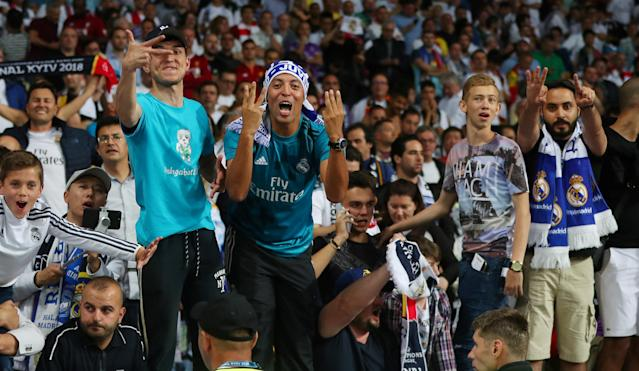 Soccer Football - Champions League Final - Real Madrid v Liverpool - NSC Olympic Stadium, Kiev, Ukraine - May 26, 2018 Real Madrid fans celebrate winning the Champions League at the end of the match REUTERS/Hannah McKay