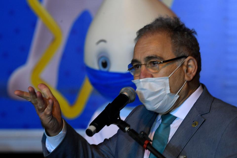 Brazilian Health Minister Marcelo Queiroga delivers a speech upon the arrival of a container with 1,000,000 doses of the Pfizer-BioNTech vaccine against COVID-19 at the Viracopos International Airport in Campinas, some 100 km from Sao Paulo, Brazil on April 29, 2021. - Brazil received Thursday a first lot of 1,000,000 doses of the Pfizer-BioNTech vaccine developed by US drugmaker Pfizer and BioNTech of Germany. (Photo by NELSON ALMEIDA / AFP) (Photo by NELSON ALMEIDA/AFP via Getty Images)