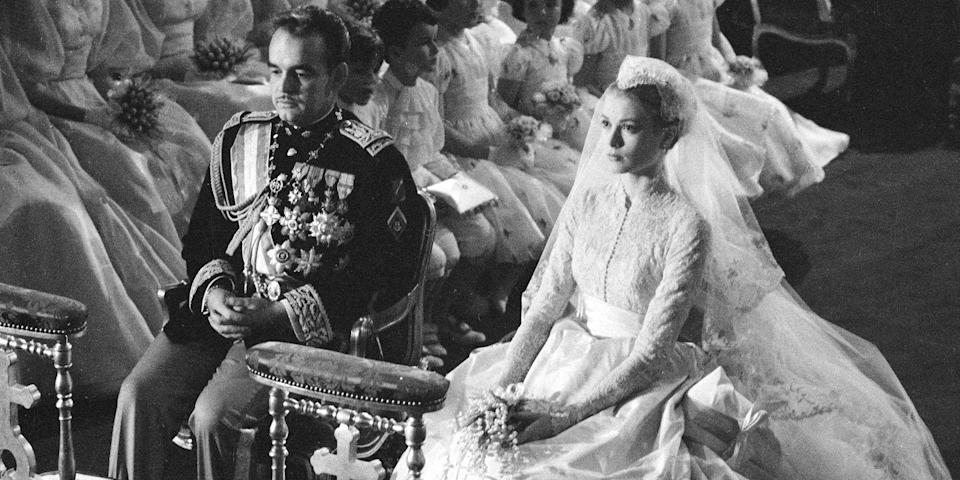 <p>There was a lot of fanfare surrounding Grace Kelly's wedding to Prince Rainier of Monaco, as the Hollywood actress was saying farewell to the industry and joining the ranks of royalty. Per tradition, the couple had two wedding ceremonies. First a civil service, where the bride wore a simple blushed colored lace dress, then a religious ceremony, which is when Kelly wore her famous high neck lace gown. </p>