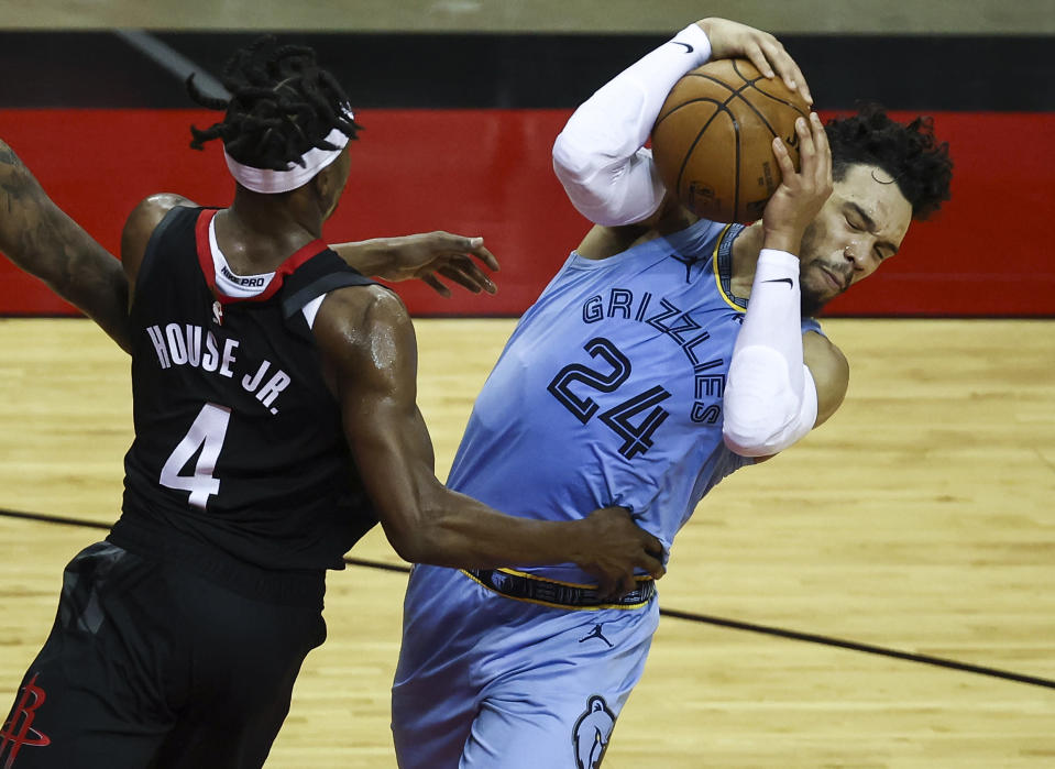 Memphis Grizzlies guard Dillon Brooks (24) attempts to keep control of the ball as Houston Rockets forward Danuel House Jr. (4) defends during the third quarter of an NBA basketball game Sunday, Feb. 28, 2021, in Houston. (Troy Taormina/Pool Photo via AP)