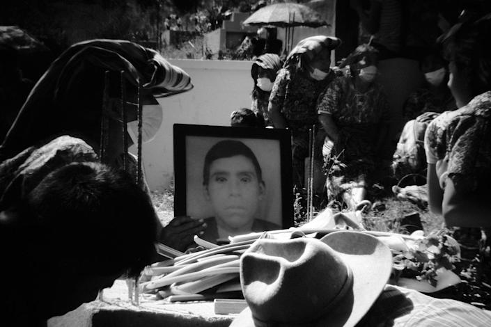 Friends and family members of Baltazar Gomez Toma bury his remains in Cotzal's main cemetery nearly 40 years after his disappearance. Cotzal, Quiche, Guatemala. February 11, 2021.