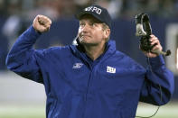 FILE - New York Giants head coach Jim Fassel reacts after referees overturned a ruling on a completed Philadelphia Eagles pass in the fourth quarter at Giants Stadium in East Rutherford, N.J., in this Monday, Oct. 22, 2001, file photo. Fassel, a former coach of the New York Giants who was named NFL coach of the year in 1997 and led the team to the 2001 Super Bowl, has died. He was 71. Fassel's son, John, confirmed the death to the Los Angeles Times on Monday, June 7, 2021. According to the Los Angeles Times, Fassel was taken to a hospital in Las Vegas with chest pains and died of a heart attack. (AP Photo/Jeff Zelevansky, File)