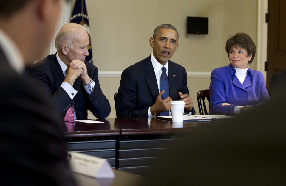 President Barack Obama, joined by Vice President Joe Biden, left, and Senior White House Adviser Valerie Jarrett, right, speaks during a Democratic Governors Association Meeting in the Eisenhower Executive Office Building on the White House campus in Washington, Friday, Feb. 19, 2016. (AP Photo/Carolyn Kaster)
