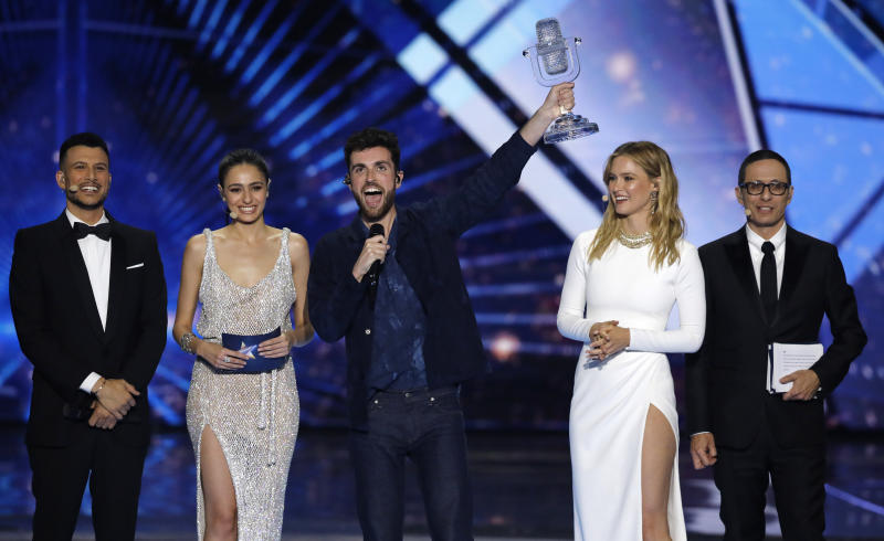 "Duncan Laurence of the Netherlands, center, celebrates with the trophy after winning the 2019 Eurovision Song Contest grand final with the song ""Arcade"" in Tel Aviv, Israel, Saturday, May 18, 2019. (AP Photo/Sebastian Scheiner)"
