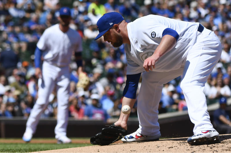 Chicago Cubs starting pitcher Jon Lester (34) makes a fielding error on a bill hit by Washington Nationals Howie Kendrick (47) during the second inning of a baseball game Friday, Aug. 23, 2019, in Chicago. (AP Photo/Matt Marton)