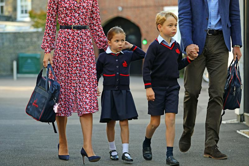 Britain's Princess Charlotte of Cambridge, with her brother, Britain's Prince George of Cambridge, arrives for her first day of school at Thomas's Battersea in London on September 5, 2019.